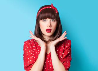 brunette girl in red dress on blue background