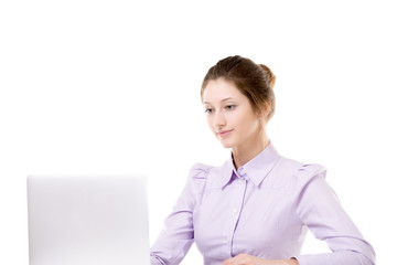 Young girl working in front of laptop
