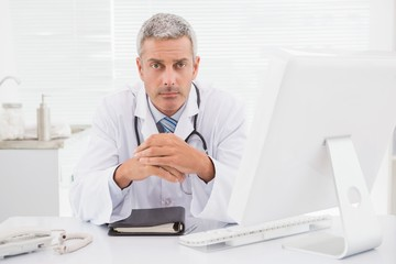 Unsmiling doctor looking at camera