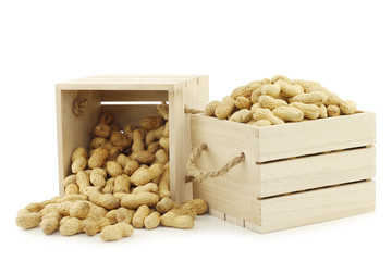 roasted peanuts in a wooden box with rope handles