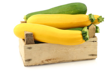 mixed yellow and green zucchini's in a wooden crate