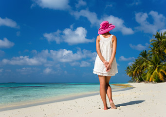 woman in a white dress on the tropical beach
