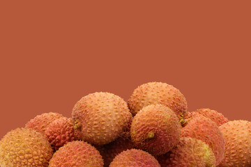 fresh lychees on a brown background