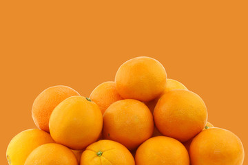 fresh oranges on an orange background