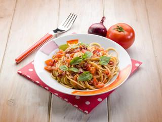 spaghetti with fresh tomato red onion and hot chili pepper