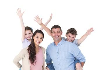 Loving parents giving piggyback ride to children