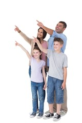 Family of four pointing at copy space