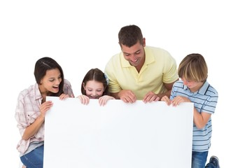 Family of four looking at billboard