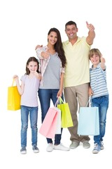 Family with shopping bags gesturing thumbs up