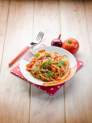spaghetti with fresh tomato red onion and hot chili pepper