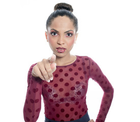 A mulatto fashion model wearing in dot over a wite background