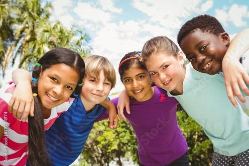 Leinwanddruck Bild Happy children forming huddle at park