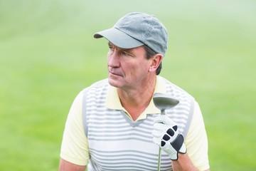 Golfer kneeling on the putting green