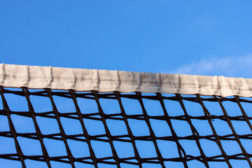 Tennis court net and sky