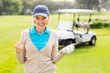 canvas print picture - Female golfer smiling at camera