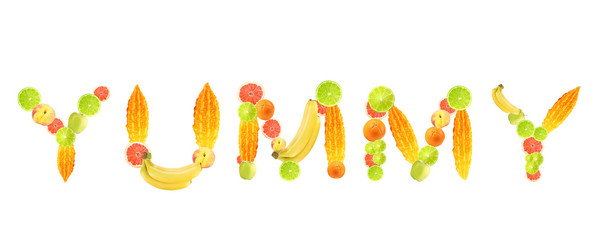 Word Yummy made of fruits isolated on white