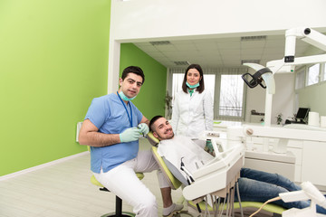 Portrait Of A Dentist , Assistant And Patient