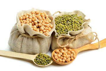 chick-pea, mung beans in the sacks and spoon wooden  isolated on