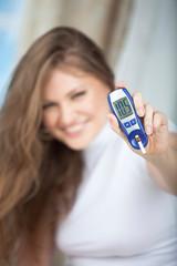 Female Diabetic Doing a Glucose Level Finger Blood Test