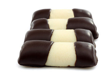 sweet marzipan chocolate rolls on a white background