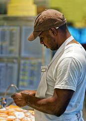 Black man working at the kitchen