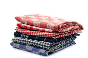 stacke colorful kitchen towels on a white background