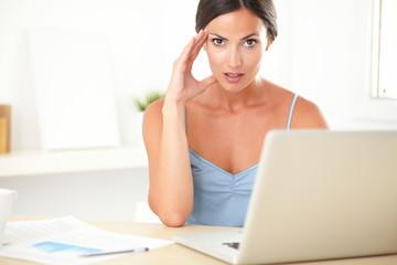 Stylish female feeling tension at work