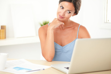 Young stylish woman sitting while studying