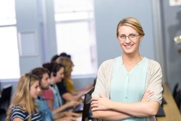 Confident female teacher in computer class