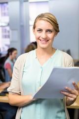 Portrait of female teacher holding document