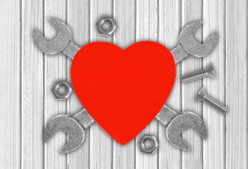 Heart and tools over wooden background. Concept: Renovation of h