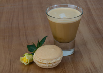 Coffee with macaroons and rose