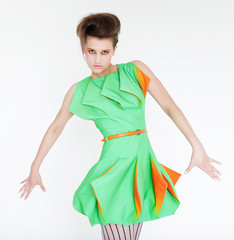 Fashion model in bright green dress