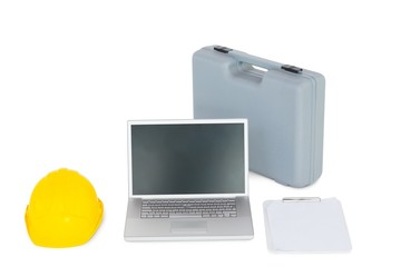 Laptop with carpentary equipment on white