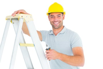 Portrait of happy repairman with pliers climbing ladder