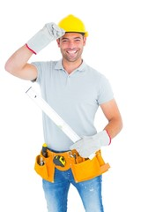 Smiling handyman holding spirit level