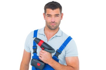 Portrait of confident carpenter holding power drill