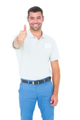 Happy male technician gesturing thumbs up