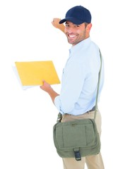 Smiling postman with letter knocking on white background