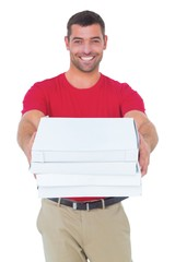 Happy delivery man giving pizza boxes