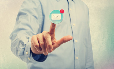 Young man pointing at an email icon