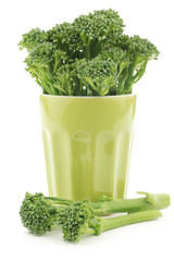 A small form of broccoli, called bimi, in a green ceramic mug on