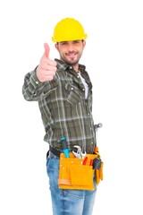 Confident manual worker gesturing thumb up