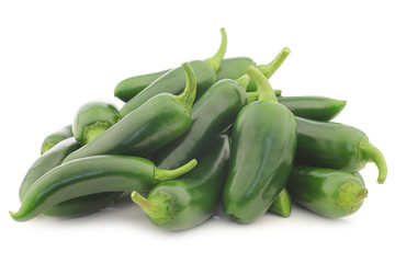 fresh green peppers (capsicum) on a white background