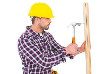 Handyman using hammer on wood