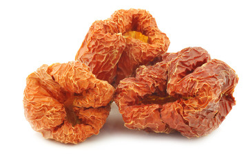 bunch of dried red bell peppers on a white background