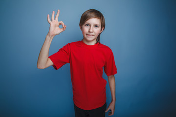 teenager boy twelve years old European appearance in a red shirt
