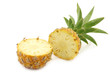 cut mini pineapple fruit on a white background