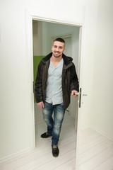 Young Man Entering Through His Front Door