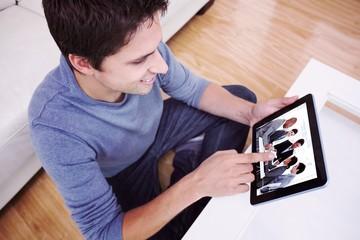 Overhead view of man using digital tablet in living room